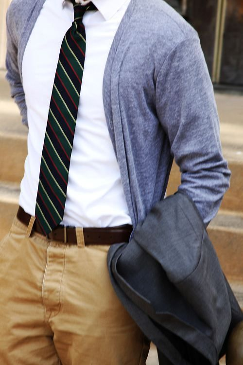 dusty blue cardigan, a striped tie and tan pants