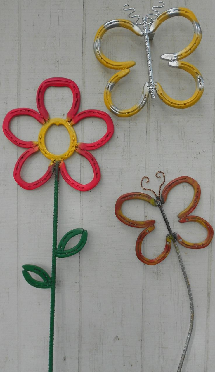 Samis horseshoe flowers and butterflies Yellow butterfly $20.00 Staked butterfly $25.00