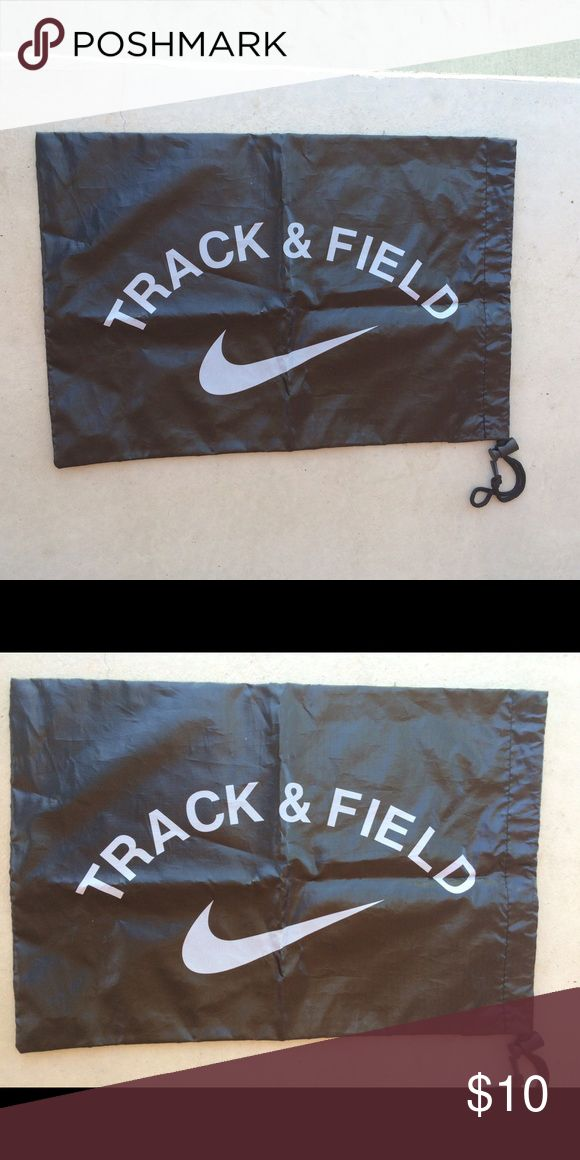 """Track and Field Bag Black bag that cinches/closes at the side with white letters and a Nike symbol that says """"track and field."""" Perfect to put clothes, water bottles, or athletic shoes in. A little wrinkled, but in perfect condition. Nike Bags"""