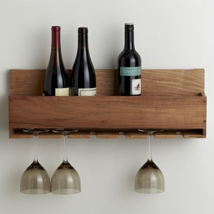 A space-saving wall rack stores wine and glasses in straightforward, farmhouse kitchen style.  Lines-up a half case of the grape, with half-dozen stemmed glasses suspended below.  Made from acacia, a wood noted for its attractive grain. Acacia woodMounting hardware not includedWipe clean with clothMade in India.