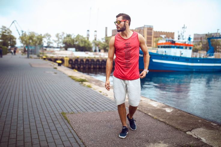 Superb styling from Bolf for summer. A red printed tank top and shorts are manufactured from breathable and high-quality cotton. They look good and wear comfortably. The whole look is complemented with sports accessories - shoes, a watch and a pair of sunglasses.