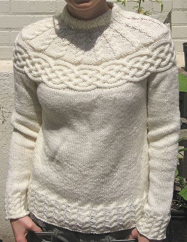 This highlight of this intricate pullover is a beautiful celtic knot-inspired cable across the yoke. Pretty sideways Celtic cabling across the yoke sets this sweater apart. (Patons Yarns)