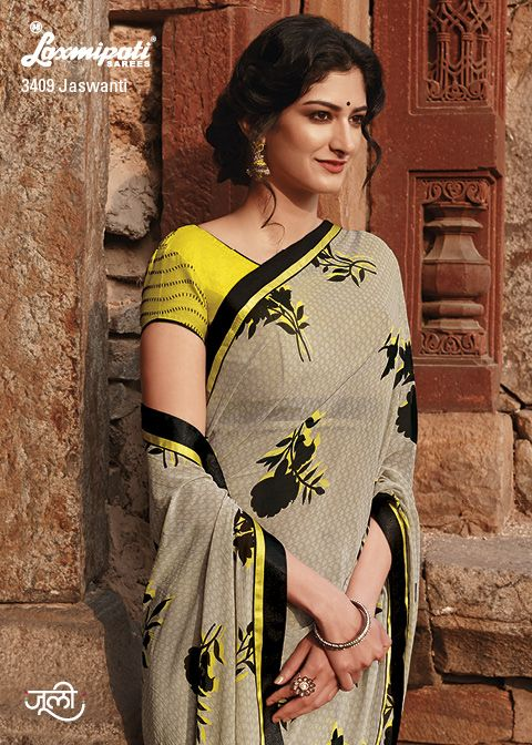 The gorgeous georgette saree is going beyond expectation by its joyful colors, prints and contrast yellow embroidery blouse piece.