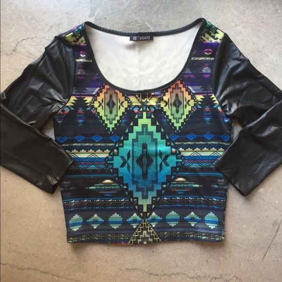 Aztec crop top 3/4 sleeve top , is great worn with high wasted pants or skirt or even sexier with a little extra skin 😉 The sleeves are leather inspired material along with the collar neck line. Tops