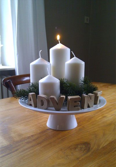 love this advent decoration - and very clever - as you lit the tallest candle first on the 1st Sunday in Advent, the 2nd tallest the 2nd Sunday in Advent etc...