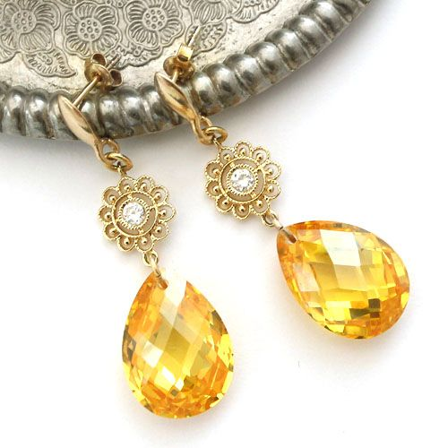 Intensely yellow cubic zirconia drops and gold-plated silver and brass. Very sophistcated and elegant earrings.