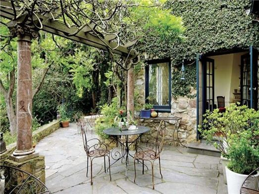 patio with a lattice cover - wine grapes growing on it (saw this at a house for sale that we viewed - incredibly easy to do yourself; so romantic!)