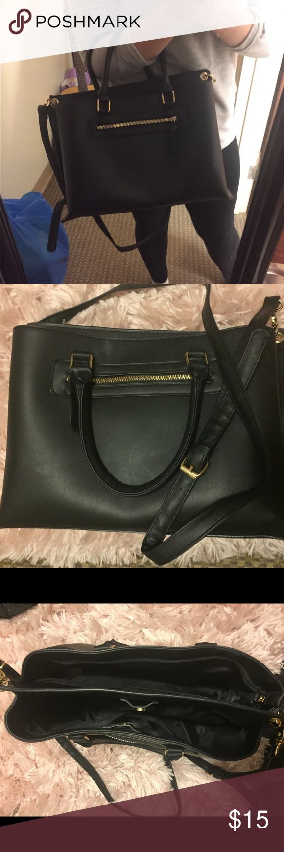 Large Black Purse Very firm, not flimsy at all! Very large and can hold all your things! Has a long strap as well. Primark Bags Totes