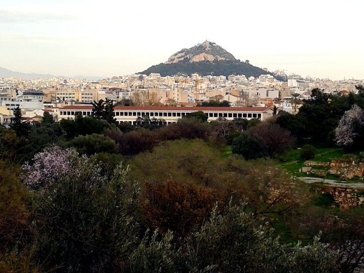 """First touches of Spring in the heart of Athens. Time moves on while Attalos' Archway remains an immovable """"train""""..."""