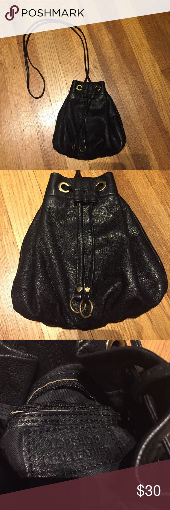 Topshop leather purse Topshop small leather buckle bag that can be worn as a crossbody. Large enough for cell phone, a bit of makeup, and small wallet. Perfect for dancing on friday nights! Cinches closed with one internal zipper pocket. Topshop Bags Mini Bags