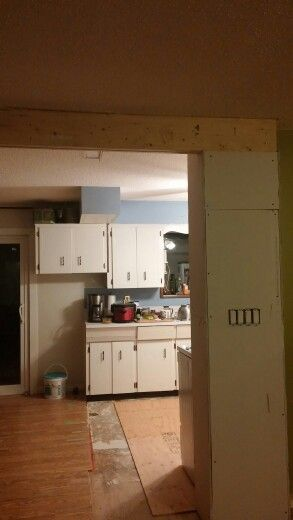 After, beam and all were moved and house has better support now. More open now. This is where breakfast bar will go.