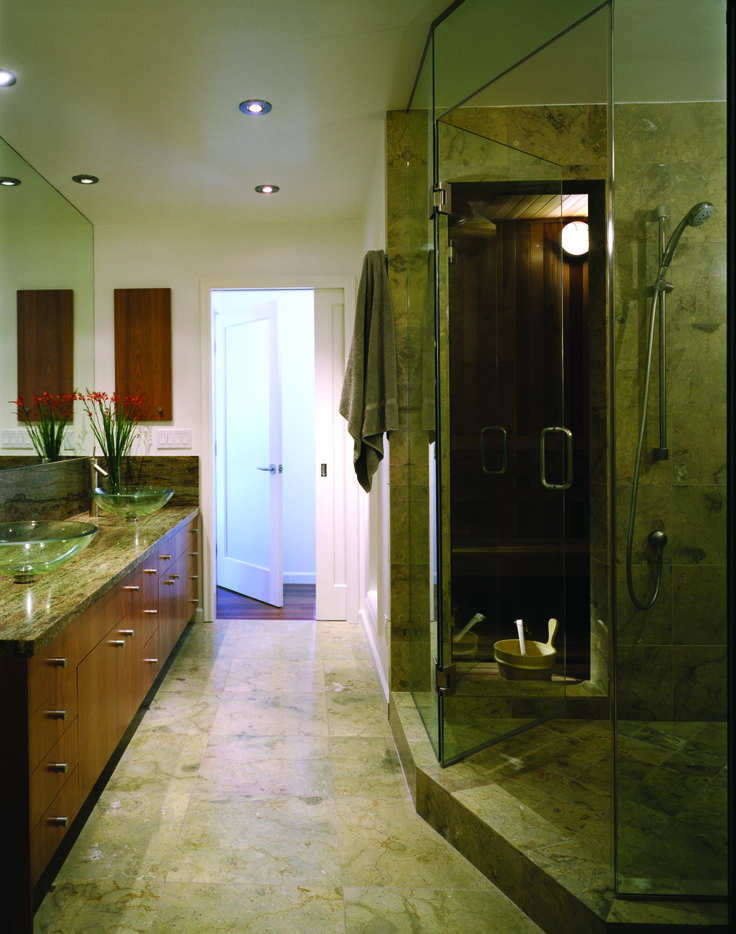 In the master bathroom are two glass sinks on a stone for Master bathroom with sauna
