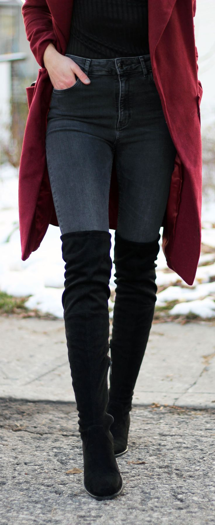 Winter style to keep warm: a long duster coat in this berry color paired with over the knee black boots. By fashion blogger Marie's Bazaar