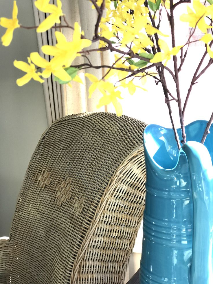 Using two colors on an old wicker chair creates depth of color as light moves across the chair     #spon Fusion Mineral Paint   The Chelsea Project   www.thechelseaproject.com