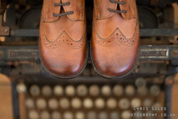 page boys shoes on a typewriter