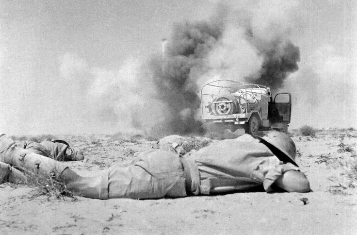 By September 1941 there were nearly 60,000 South African troops in Egypt, 15,000 of them black: all had volunteered to serve outside South Africa, and wore an orange strip on their epaulettes to mark the fact. 1st South African Division was bloodily engaged during Operation Crusader, and the over 10,000 South Africans were captured when Tobruk fell. These South Africans take cover while their truck is bombed, June 4, 1942.