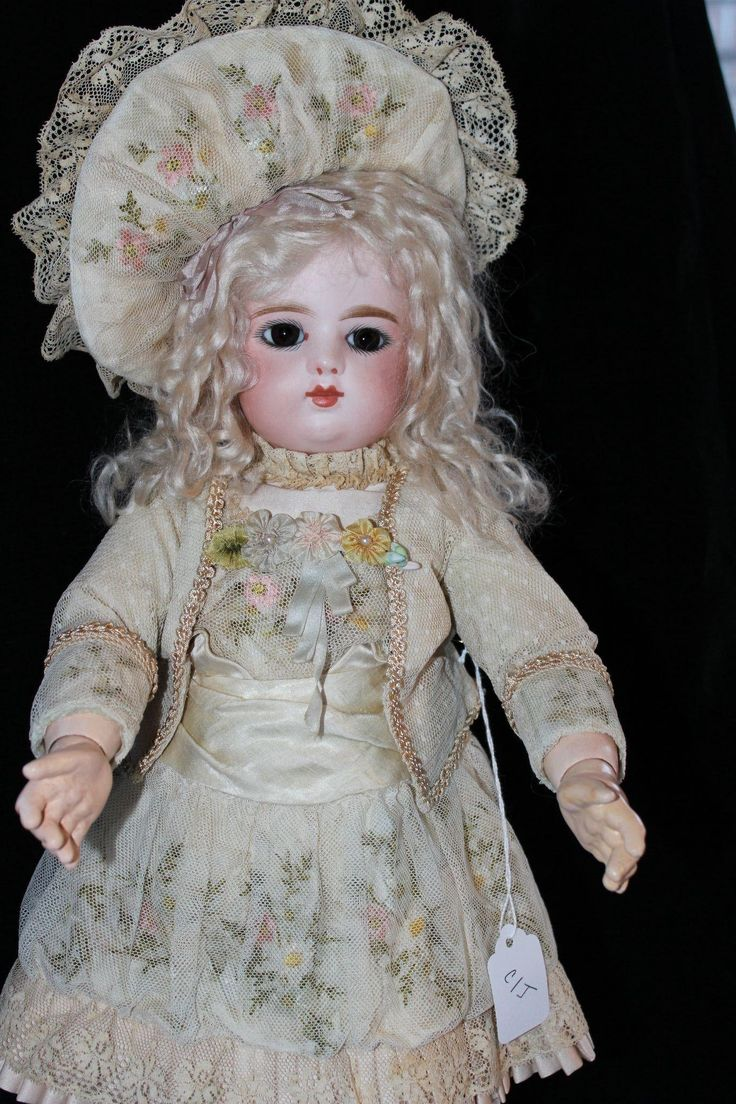 This is a beautiful 19 inch FG BeBe with the scroll mark. This fantastic little girl has beautiful brown paperweight eyes, feathered brows and