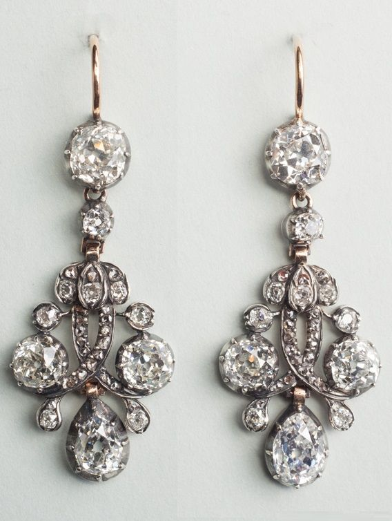 A pair of antique silver, gold and diamond earrings, Netherlands, mid 19th century.