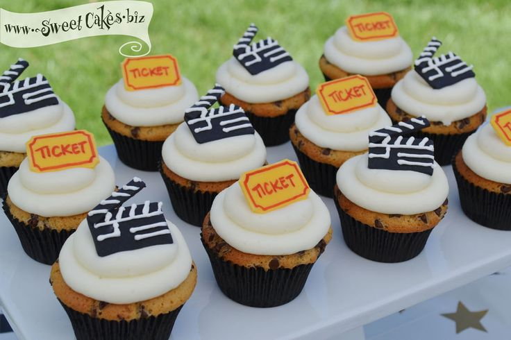 movie themed chocolate chip cookie dough cupcakes with director board and movie ticket fondant toppers