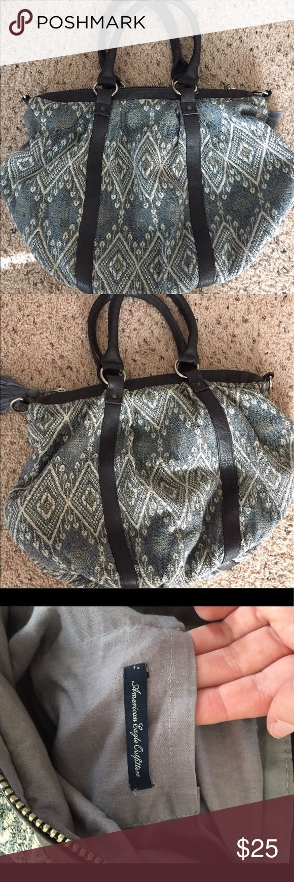 American eagle handbag Basically new. Gray and denim blue colored. Tassel on zipper. American eagle brand. American Eagle Outfitters Bags