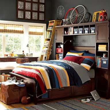 For some reason I always love teenage boy's room styling....although let's admit it- the number of teens who have a room that looks like this is probably 1 out of every 500,000 or so. ;)
