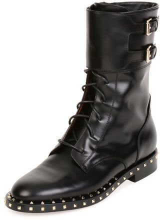 """Valentino calf leather moto boot. Signature platino Rockstud trim. 0.8"""" flat stacked heel. Round toe. Lace-up front. Two buckle straps on shaft. Side zip eases dress. Lugged rubber sole. """"Soul Stud"""" is made in Italy."""