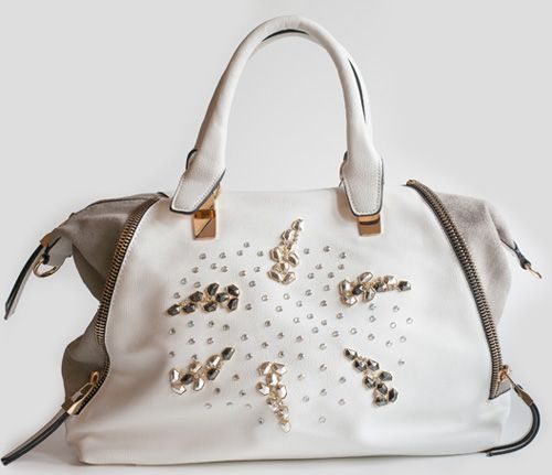 White Rock handbag with grey suede details. It's decorated with silver and black metal stones and white rihnestones. Adadi Accessories