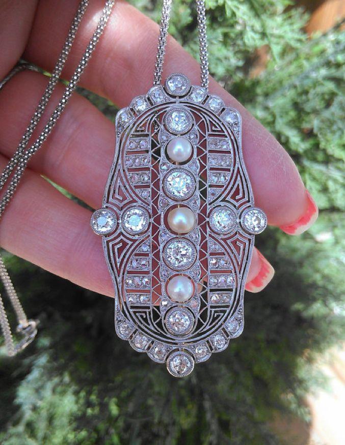 Diamond, pearl and platinum Art Deco brooch/pendant.