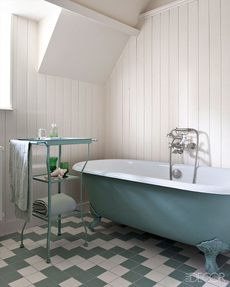 A Renovated Home In Normandy - Franz Potisek Normandy Home -  Floor patterned tile with an awesome historic tub!