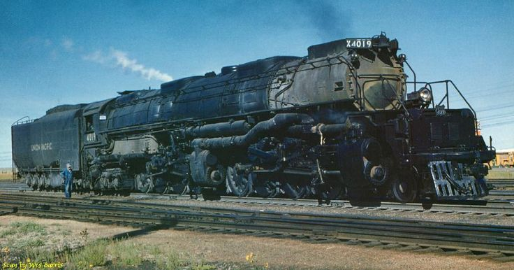 "Union Pacific 4-8-8-4 ""Big Boy"" Locomotive 4019 and engineer take a brief rest from their work at Cheyenne, WY during the Big Boys' final summer. Photo by R. H. Kindig, 1958."