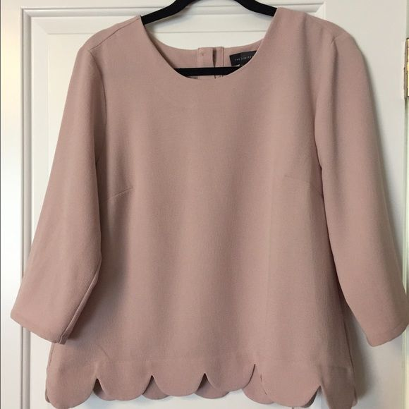 Limited Swing top L Limited blouse in size L. Neutral blush color with 3/4 sleeves. Scalloped waistline. Flattering for every figure. Perfect with jeans or dress pants for the office. Limited Tops Blouses