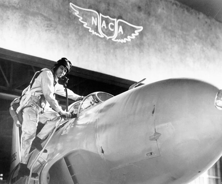 Test pilot Lawrence A. Clousing climbs into his Lockheed P-80 aircraft for a test flight at the Ames Aeronautical Laboratory, Moffet Field, California, 1948, public domain via Wikimedia Commons.