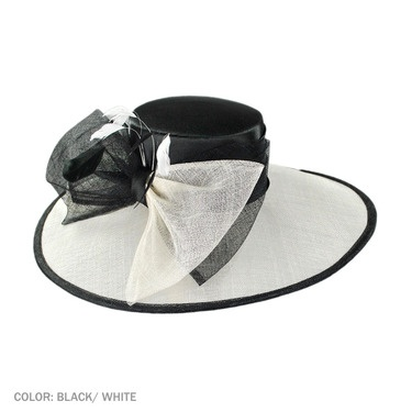 Classic design with a large bow and tonal feathers. From @krystal espeland Hat Shop - Official Hat Sponsor of the 2013 Del Mar Thoroughbred Club.