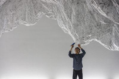 YASUAKI ONISHI'S FLOATING MOUNTAIN MADE OUT OF PLASTIC SHEETING & HOT GLUE