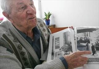 Hitler's bodyguard Rochus Misch points to a picture of Adolf Hitler he had taken in Berchtesgarden, southern Germany, in the early 1940s. Misch, who was the last remaining witness to the Nazi leader's final hours in his Berlin bunker,  died Thursday.