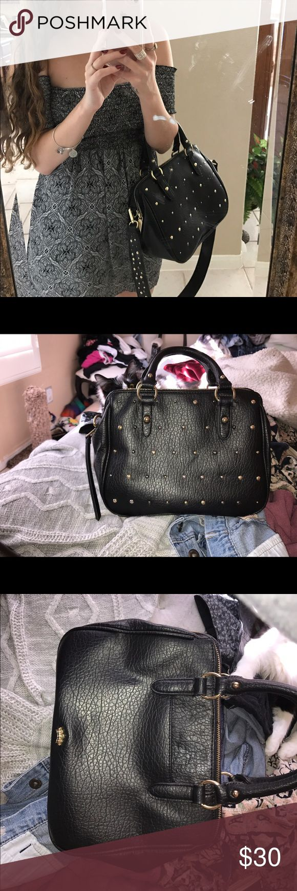 SALE!black leather studded juicy couture purse Black multicolored studs crossbody leather feel. New condition very cute juicy couture bag. Blue interior Bags