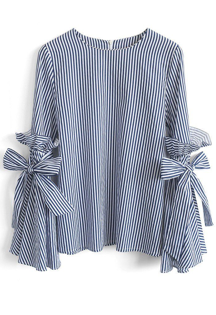 Gotta earn your stripes, babe, and there's no better way to own them than this dramatic Charisma top with bell sleeves, ruffles and self-tie bows.    - Bell Sleeves with Self-tie bowknot and ruffles  - Spilt cuffs  - Concealed back zip closure  - Not lined  - 100% Cotton  - Hand wash    Size(cm)Length Bust Shoulder Sleeves  XS/S       61    90    37      58  M
