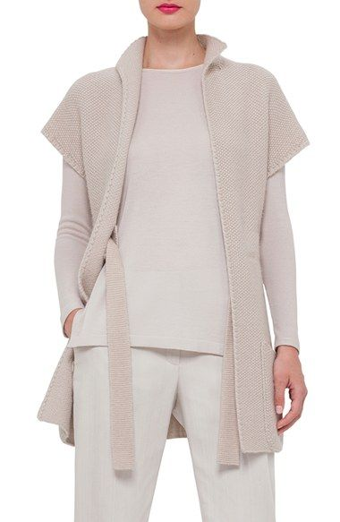 "Free shipping and returns on Akris Purl Stitch Cashmere & Silk Knit Vest at Nordstrom.com. <p><b style=""COLOR:#990000"">Pre-order this style from the Pre-Spring/Resort 2016 collection! Limited quantities. Ships as soon as available. You'll be charged only when your item ships.</b></p><br>Crafted from a luxe cashmere-silk knit in a muted neutral hue, this cap-sleeve sweater vest makes for a versatile layering piece. An interior drawstring tie belt cinches the loose silhouette to help define…"