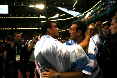 """Argentina's """"Los Pumas"""" celebrating with fans after winning to Ireland in the quarter finals of the Rugby World Cup."""