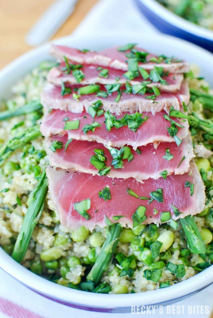 "Spring Quinoa Risotto and Seared Ahi Tuna Bowls Combine edamame, asparagus sweet peas and arugula in a creamy rice dish topped with sushi quality, ""thaw and serve"" ahi tuna with a Garlic-Peppercorn Rub.  http://www.beckysbestbites.com/spring-quinoa-risotto-seared-ahi-tuna-bowls/?utm_campaign=coschedule&utm_source=pinterest&utm_medium=Becky%27s%20Best%20Bites&utm_content=Spring%20Quinoa%20Risotto%20and%20Seared%20Ahi%20Tuna%20Bowls #healthyrecipe #dinnertonight"
