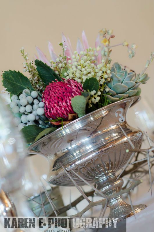 Mixed Protea, Aloe & Succulent Arrangement in a Large Silver Rose Bowl - w/ Mixed Metallic Votives, Silver Candlesticks, Acacia Branch.