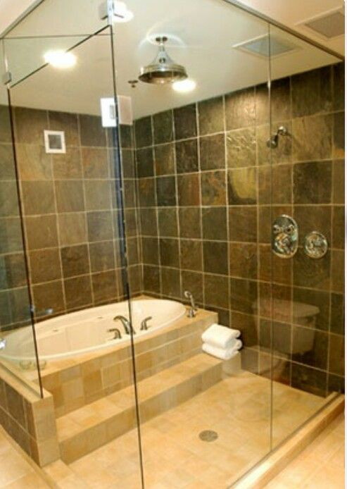 Bathtub inside shower. Nice Design and it would be nice to step from a bath full of bubbles and quickly wash off in the shower