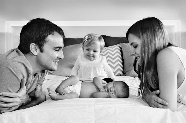 So beautiful! Family of four newborn pictures. great way to have sibs in pic without having to have one year old hold newborn!!!
