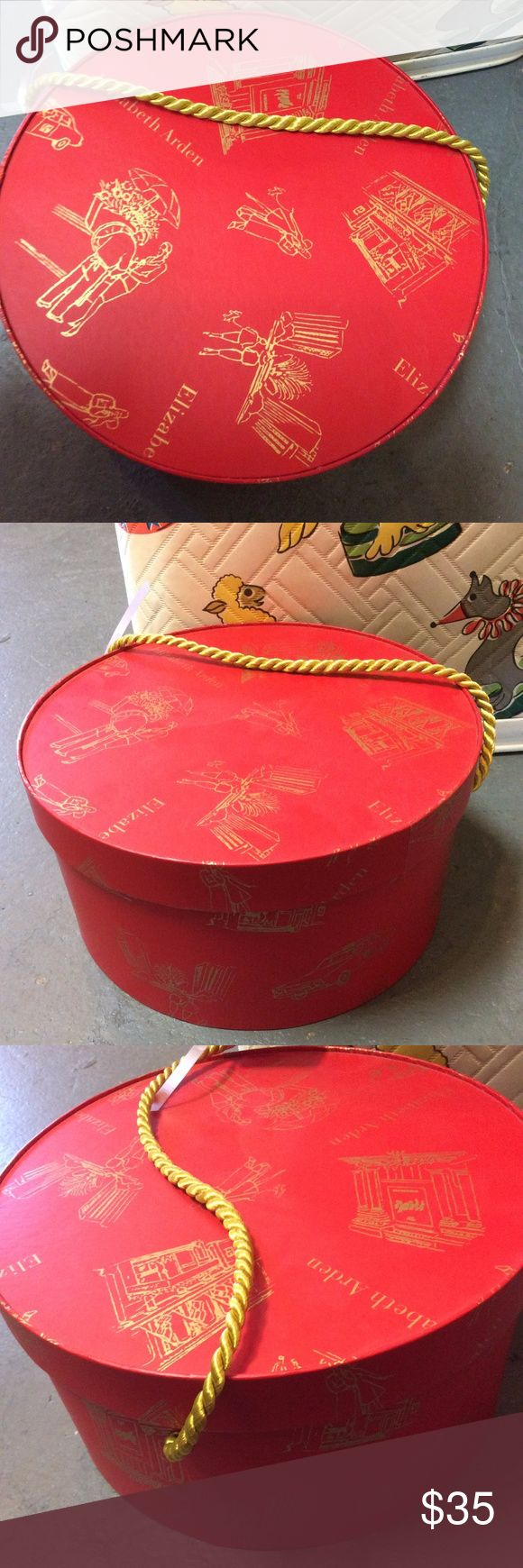 OBO : Vintage Elizabeth Arden Red Hat Box Store your vintage or antique hats in this small/medium size round bucket with chord. Romantic street scenes. flowers and umbrella imagery in gold. J00041108882465 Elizabeth Arden Accessories Hats