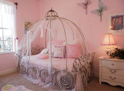 Princess themed bedroom with Cinderella carriage bed