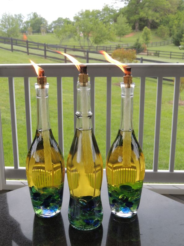 Wine Bottle Tiki Torches! With specific instructions on how to make them... pretty, clear wine bottle(s) / Crafting pebbles / Tiki fuel / Tiki refill wicks / A brass coupling doohickey (the 3/8″ x 1/4″ fits perfectly)