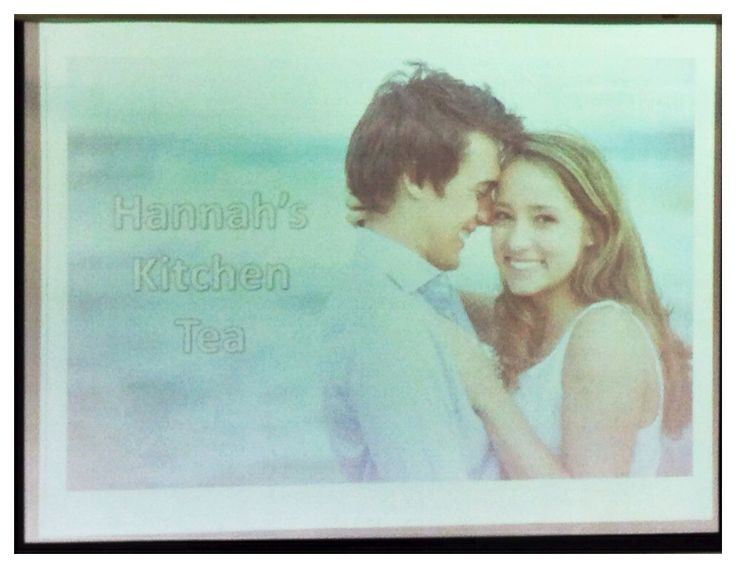 Kitchen Tea backdrop - this picture doesn't do it justice - but we just used one of the engagement pics onto the projector screen - completely free and effective. :)