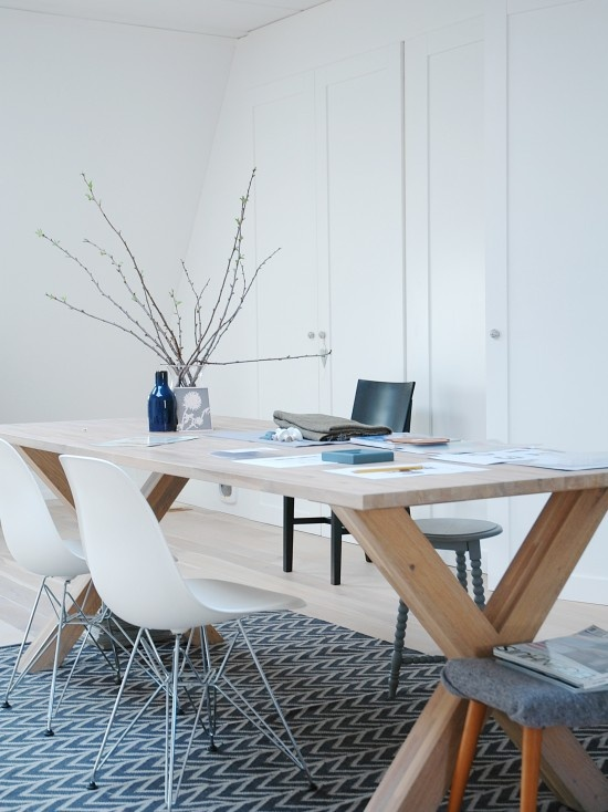 i like this natural wood desk/working/creating table and the minimalist walls and chairs
