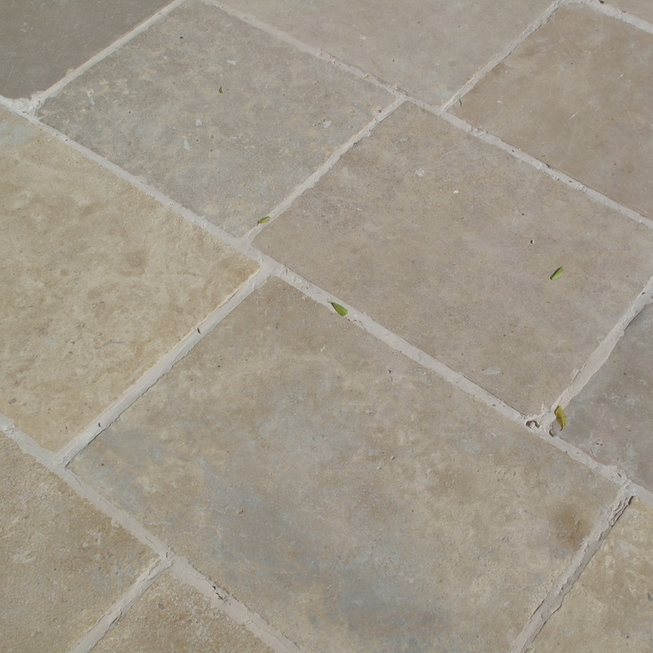 Salvaged Limestone from Traditional Reclaimed Materials in a 'running bond pattern with 3/4 inch grout'.