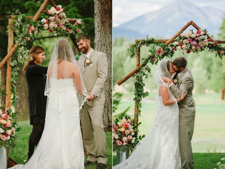 Double Arrow Resort Seeley Lake MT Wedding Photos Ceremony Kiss